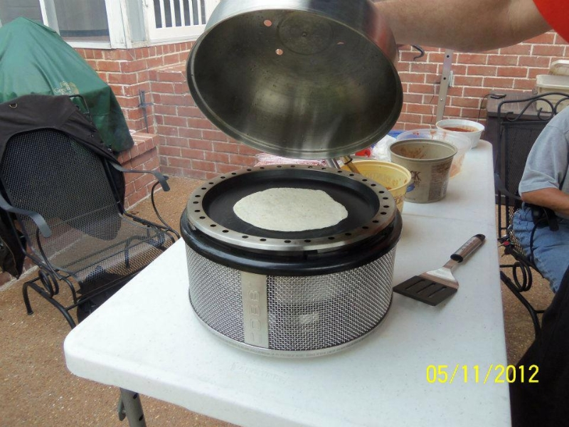 Warming the tortilla for fajitas. Notice the plastic table. Outside of grill stays cool to the touch!!